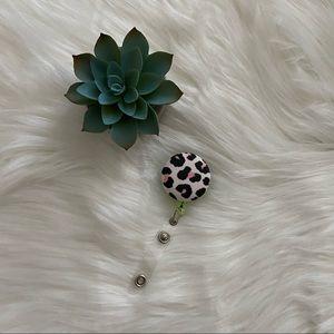 HOLD ⭐️ Pink cheetah print badge reel